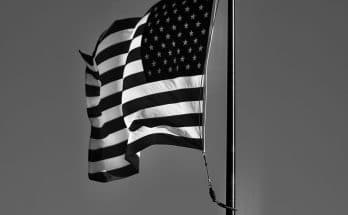 grayscale photo of us a flag
